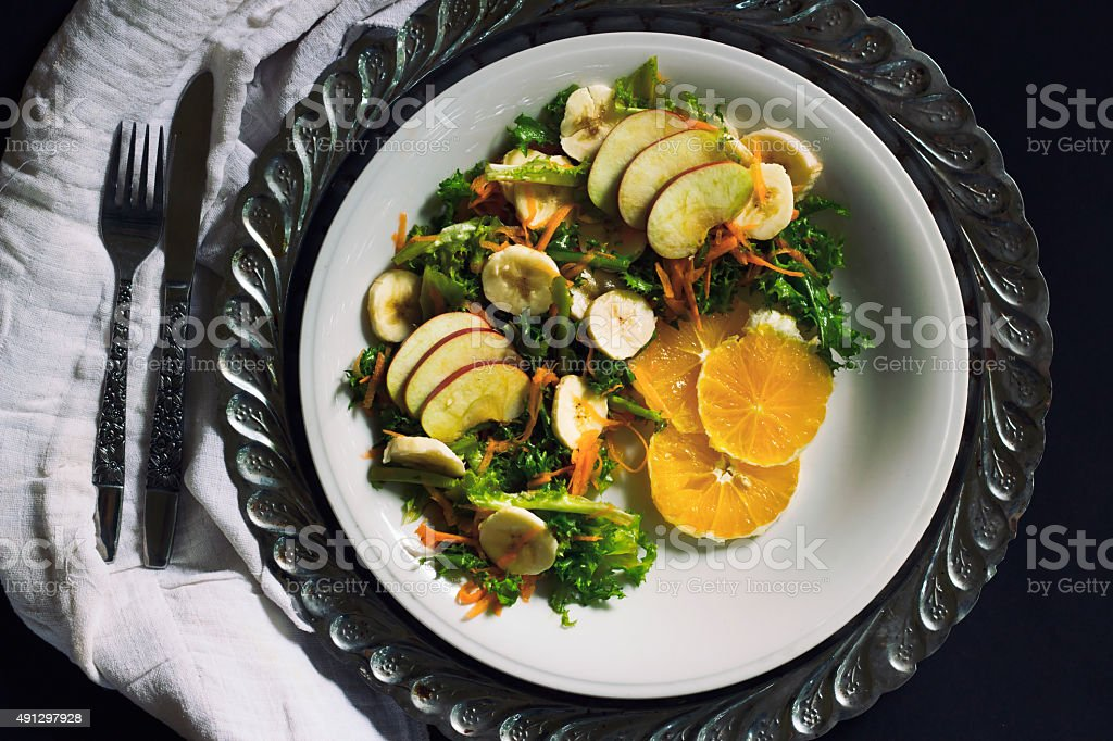 Plate of healthy green garden salad with fresh vegetables, fruits royalty-free stock photo