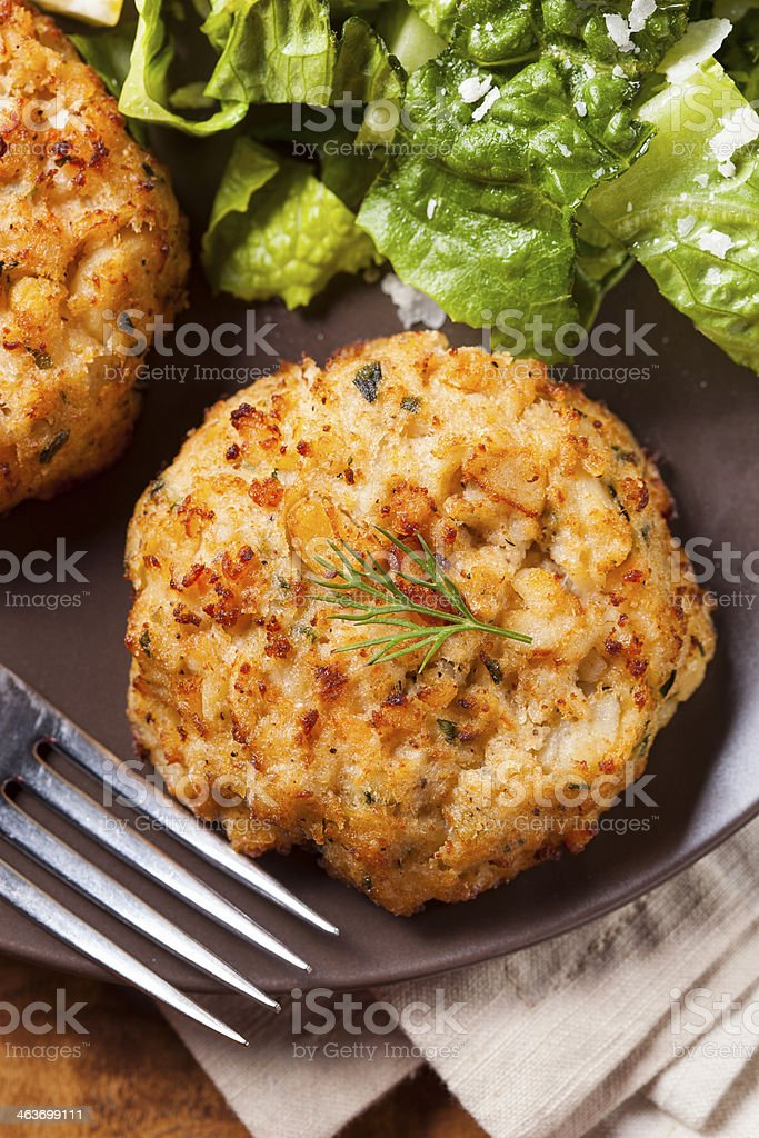 A plate of homemade crab cakes stock photo