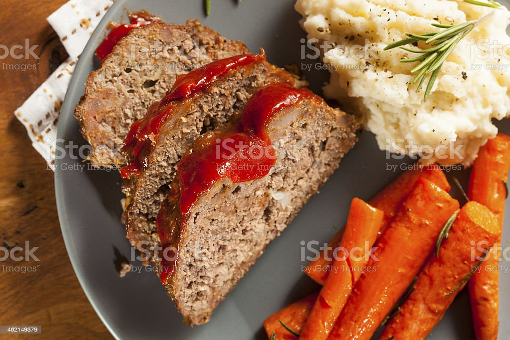 Plate of homemade ground beef meatloaf and carrots royalty-free stock photo