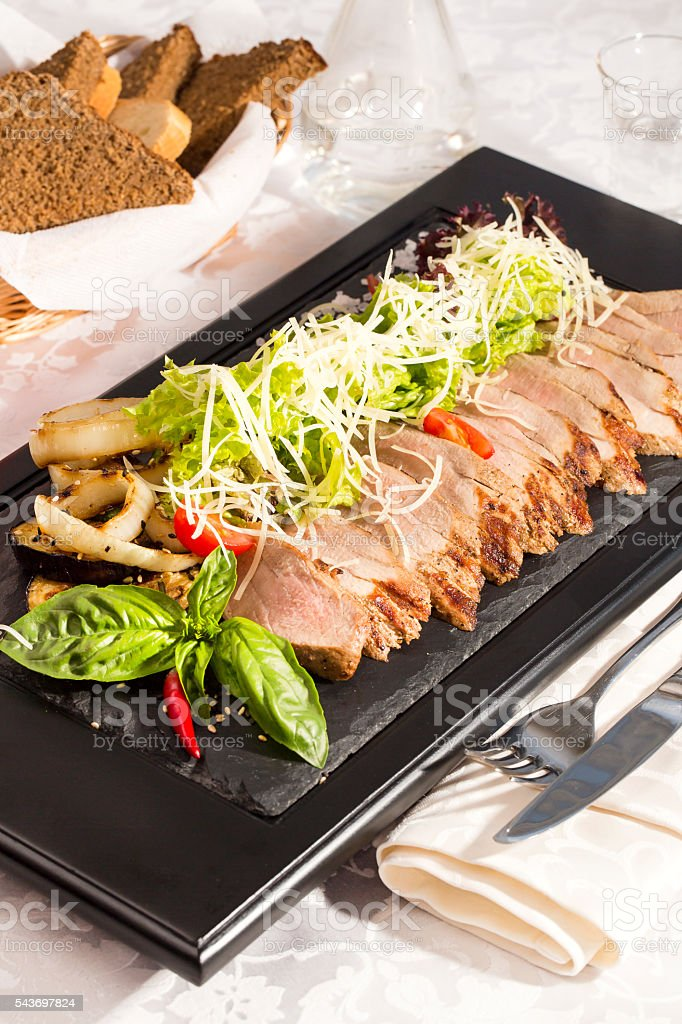 plate of meat and vegetables stock photo