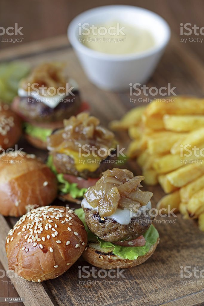 Plate of mini burgers, fries and a dip stock photo