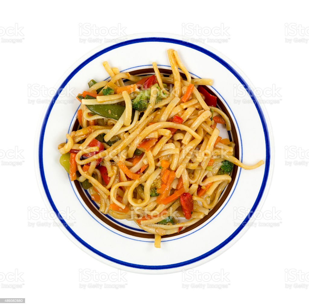 Plate of noodles and vegetables stock photo