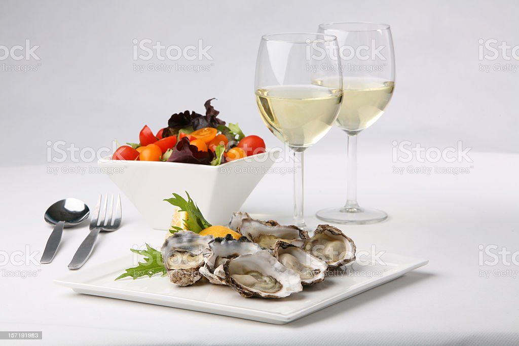 Plate of oysters with white wine stock photo