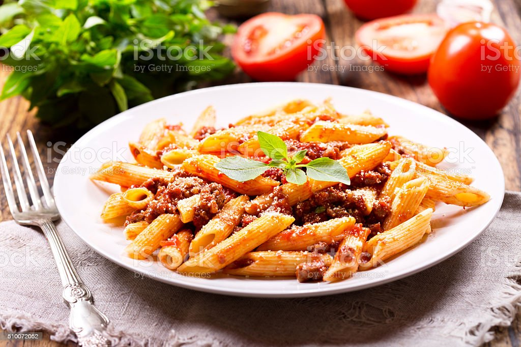 plate of pasta bolognese stock photo
