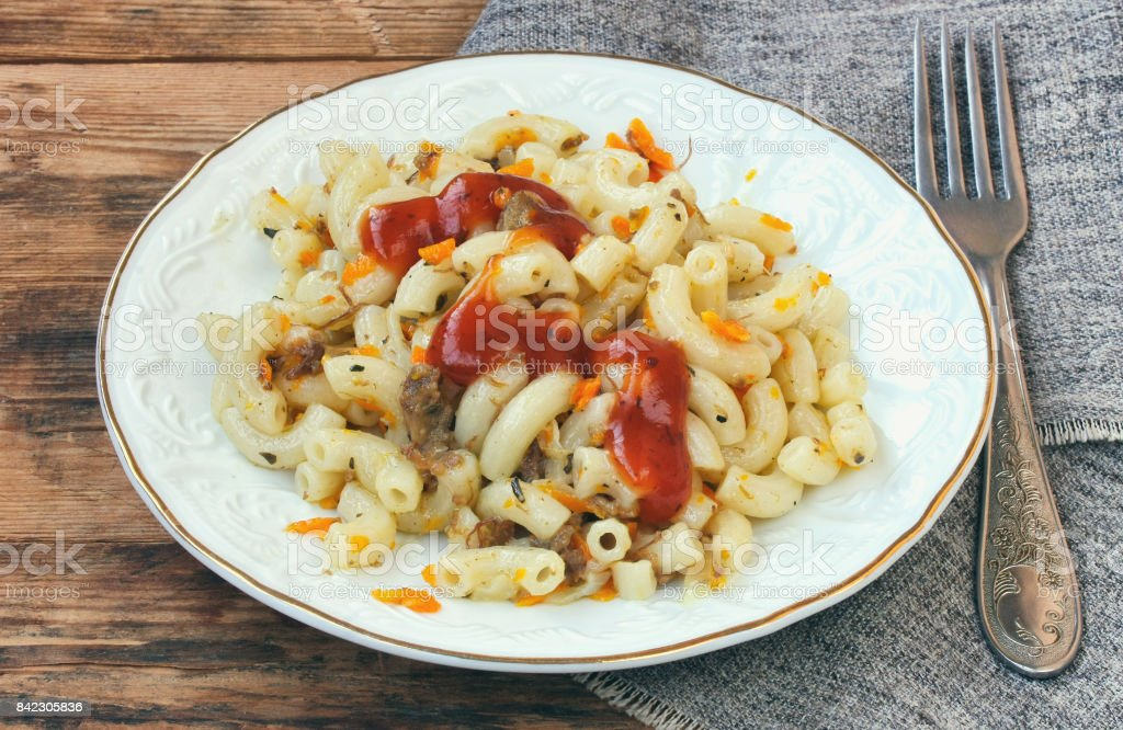 plate of pasta nautically c ground beef, ketchup, onion, carrots stock photo