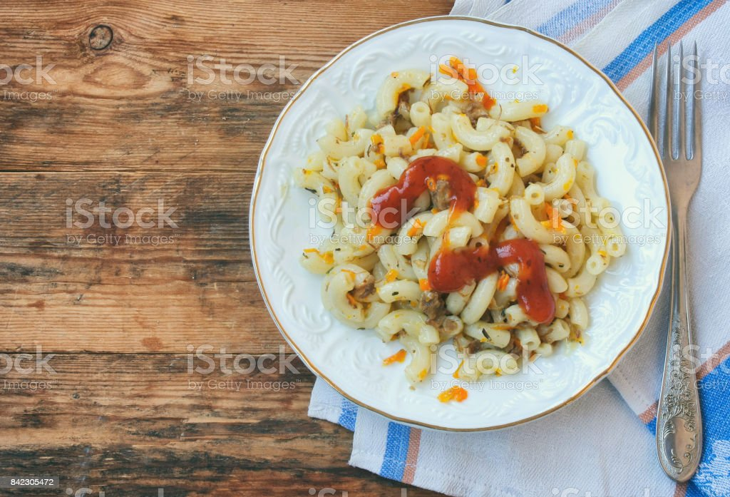 plate of pasta nautically c ground beef, ketchup, onions, carrots, vintage style stock photo