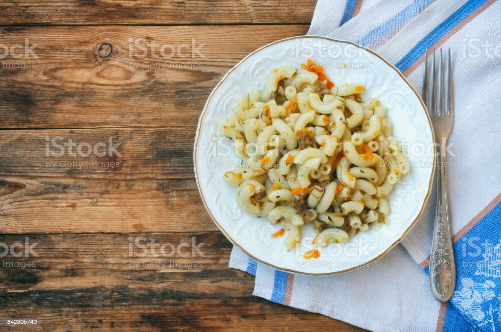 plate of pasta nautically minced meat, onions, carrots, vintage serving stock photo