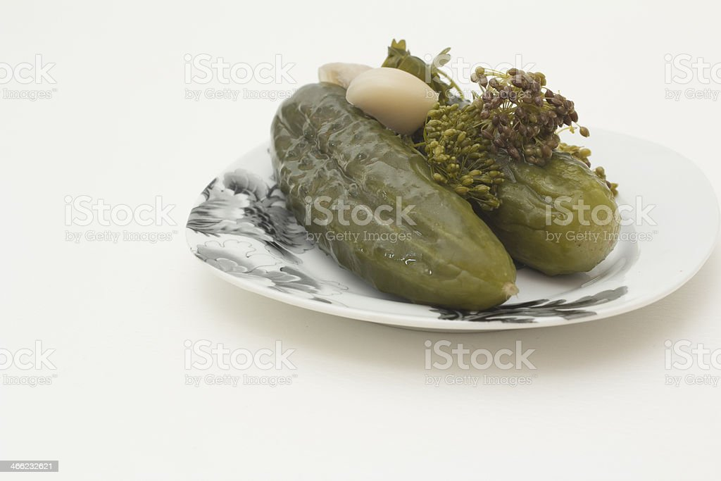 plate of pickled cucumbers isolated on white background. royalty-free stock photo