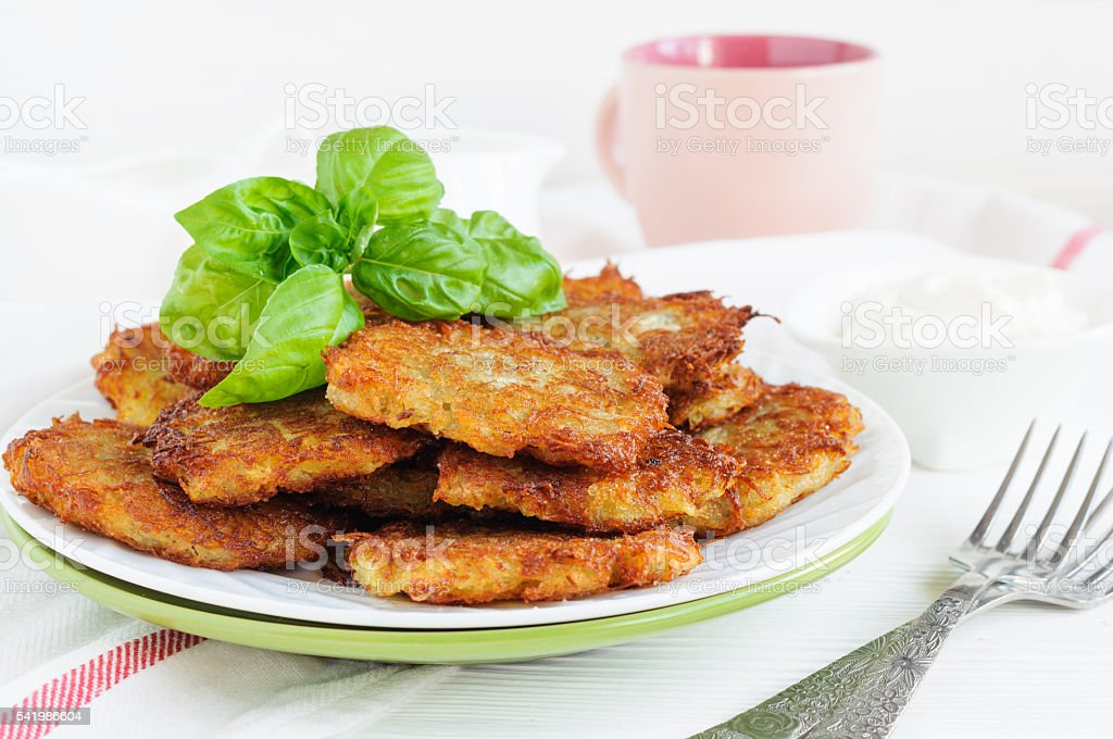 Plate of potato pancakes stock photo