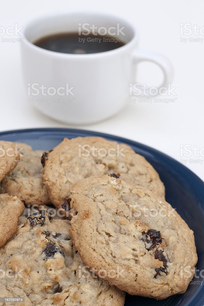 plate of raisin oatmeal cookies and coffee royalty-free stock photo