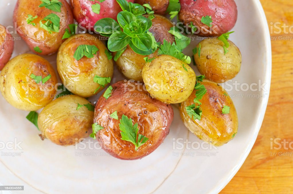 Plate of Roasted New Potatoes from Above royalty-free stock photo