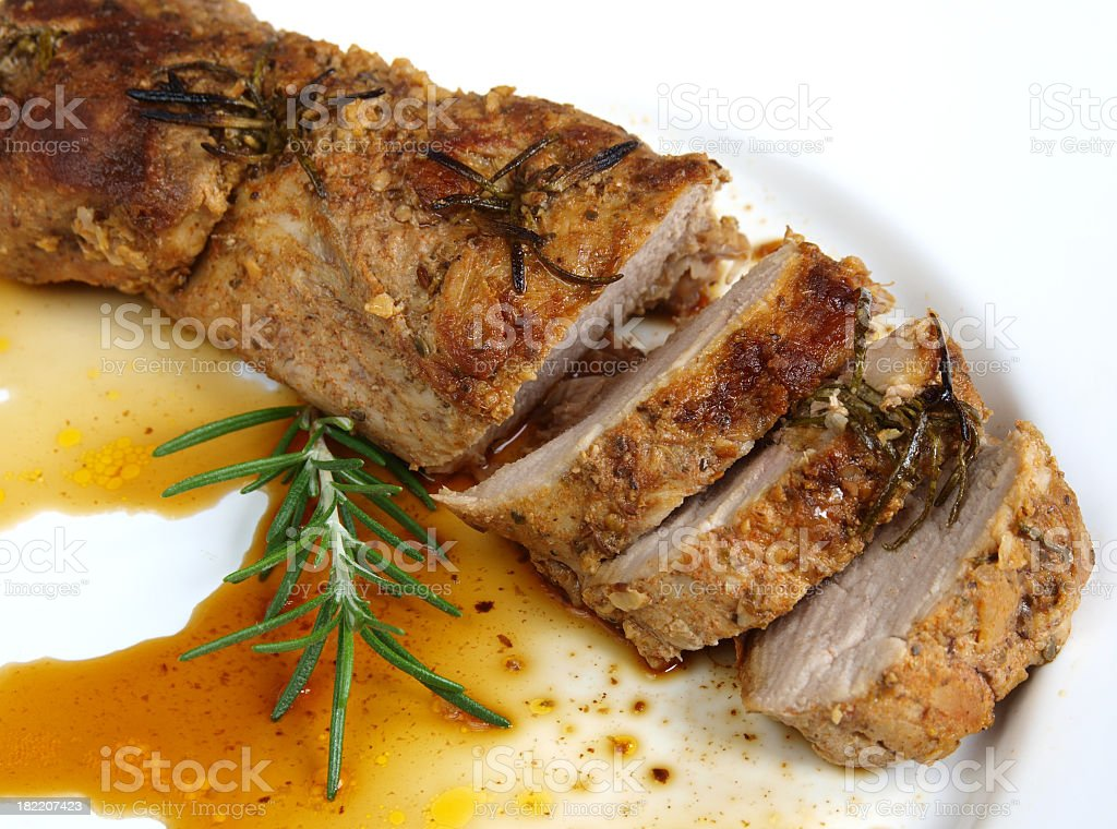 A plate of roasted pork sirloin royalty-free stock photo