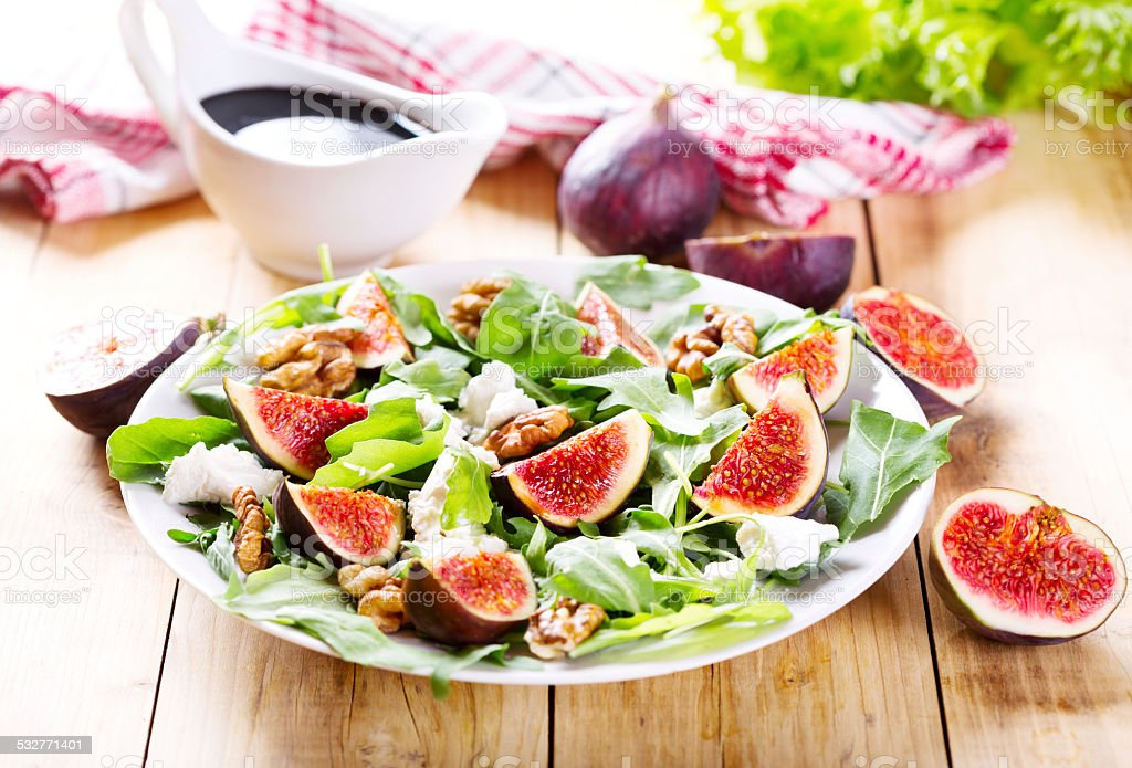 plate of salad with fresh figs stock photo