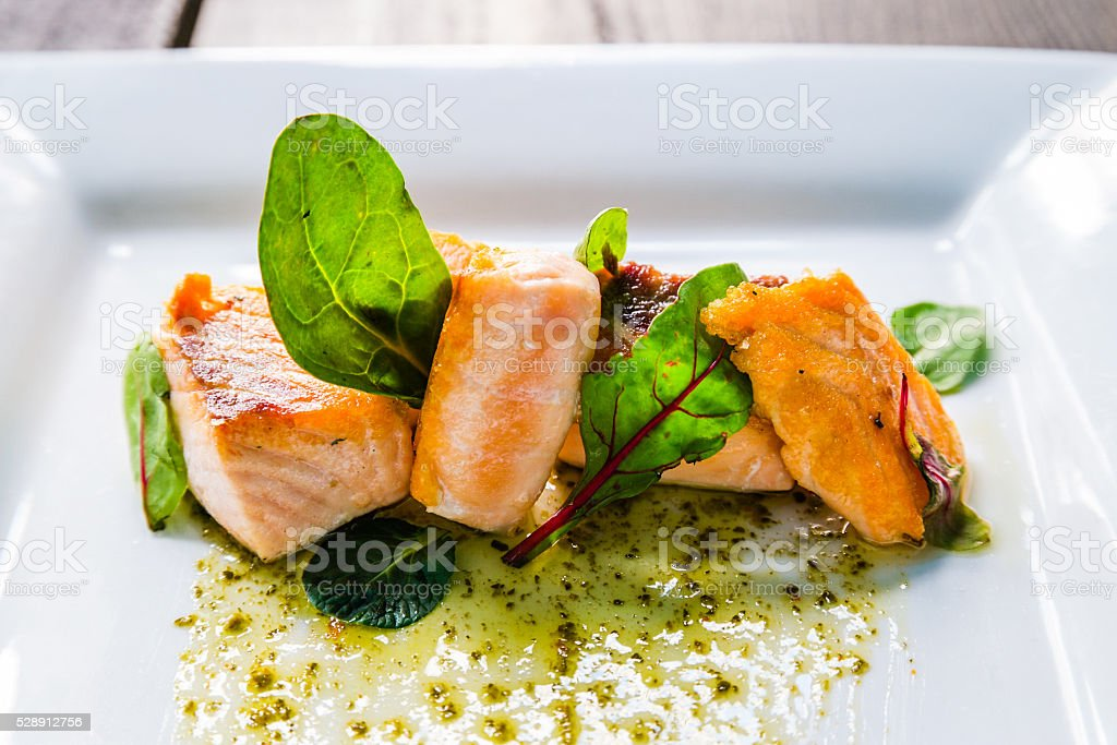 Plate of salmon and arugula stock photo