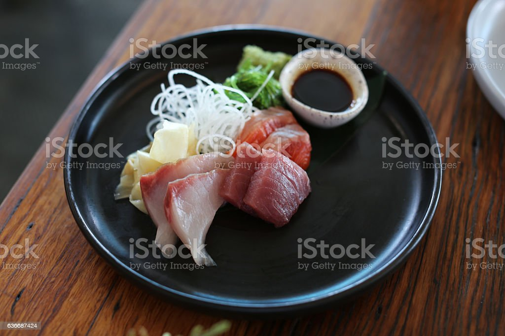 Plate of sashimi fish at a sushi restaurant stock photo