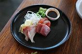 Plate of sashimi fish at a sushi restaurant