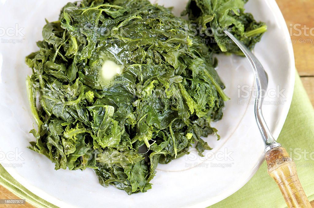 Plate of Southern-Style Cooked Greens from Above stock photo