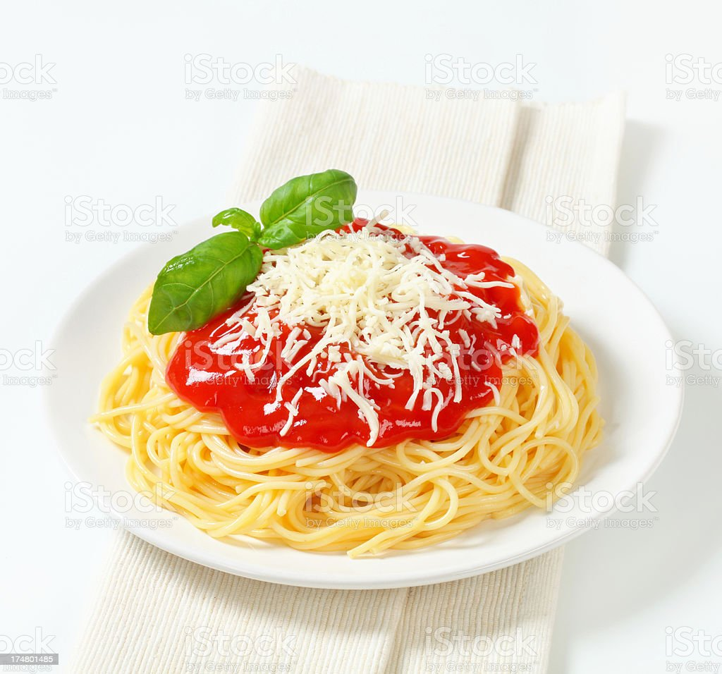plate of spaghetti with sauce, basil and cheese stock photo