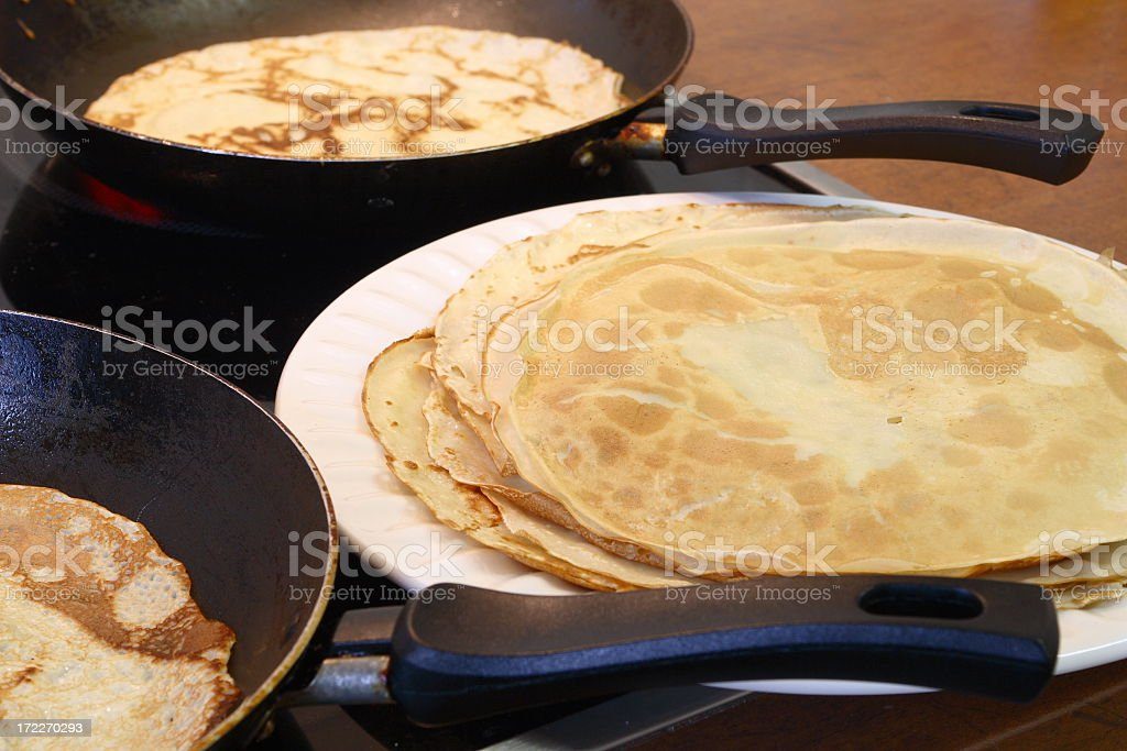 Plate of sweet pancakes and some cooking stock photo