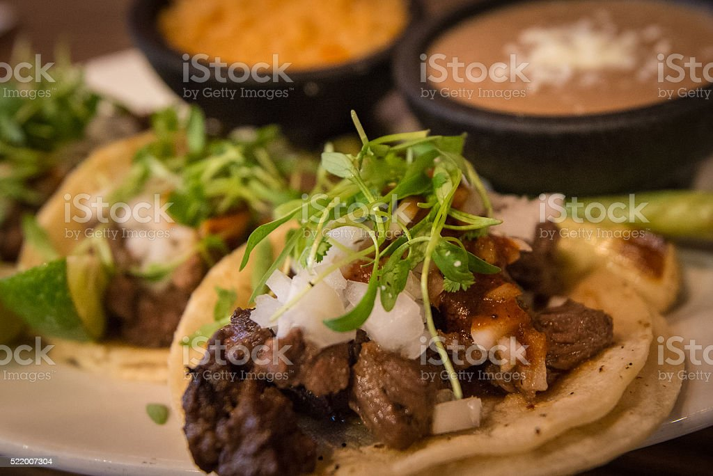Plate of three street style tacos stock photo