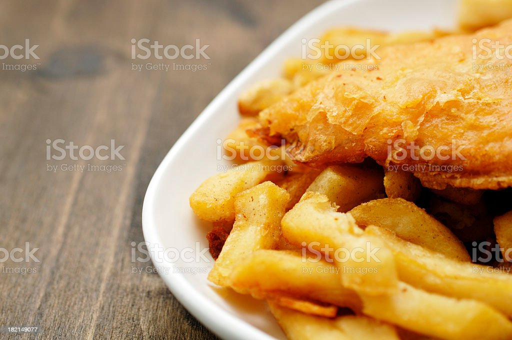 plate of traditional English fish and chips stock photo