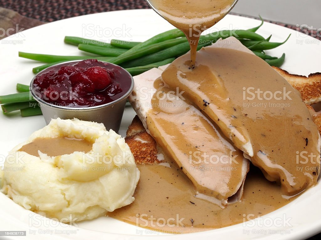 Plate of turkey with gravy, mashed potatoes and green beans stock photo