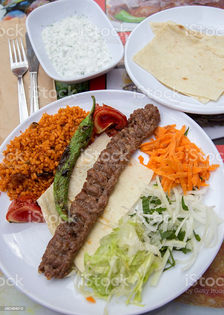 Plate of Turkish kebab meat. stock photo