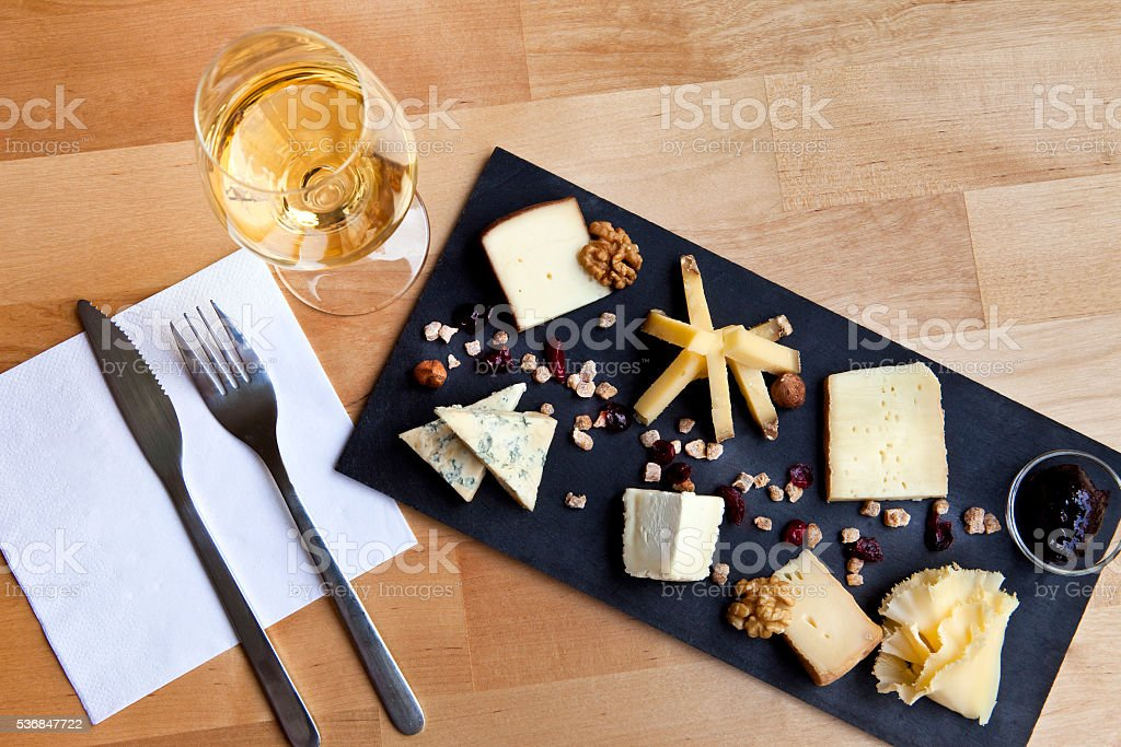 Plate of various cheese stock photo