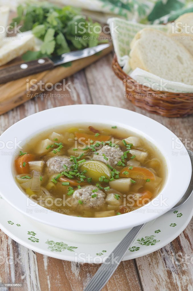 Plate of vegetable soup with meatballs royalty-free stock photo