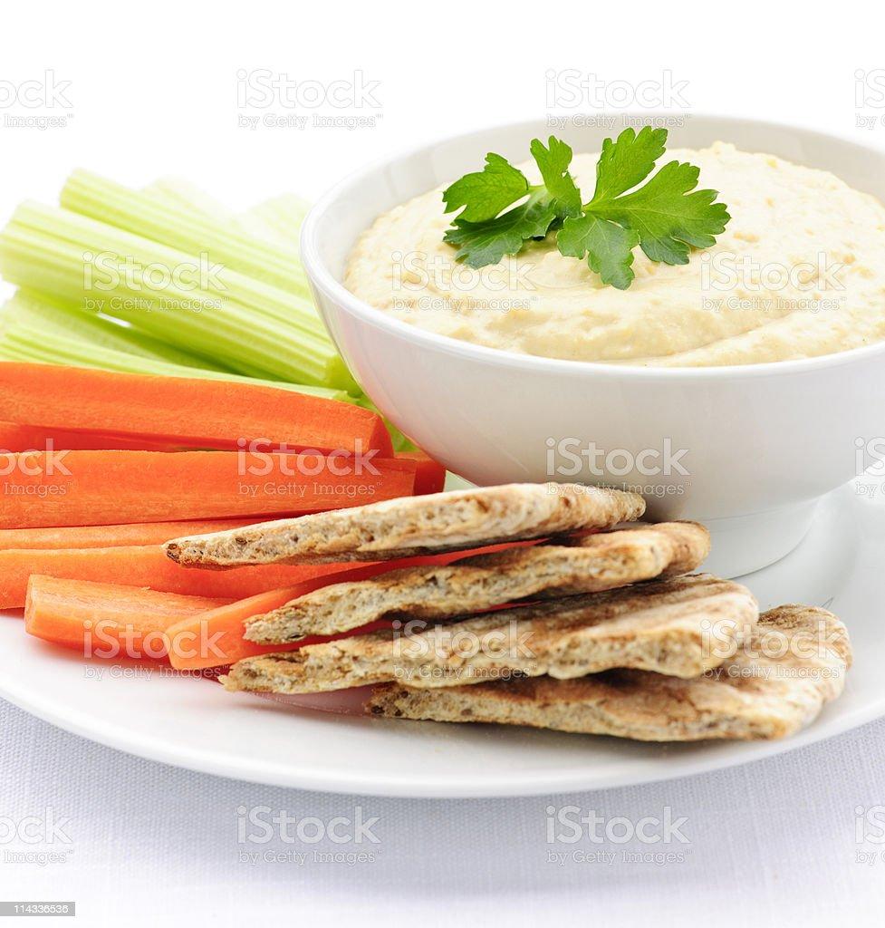 Plate of veggies and pita bread with hummus stock photo