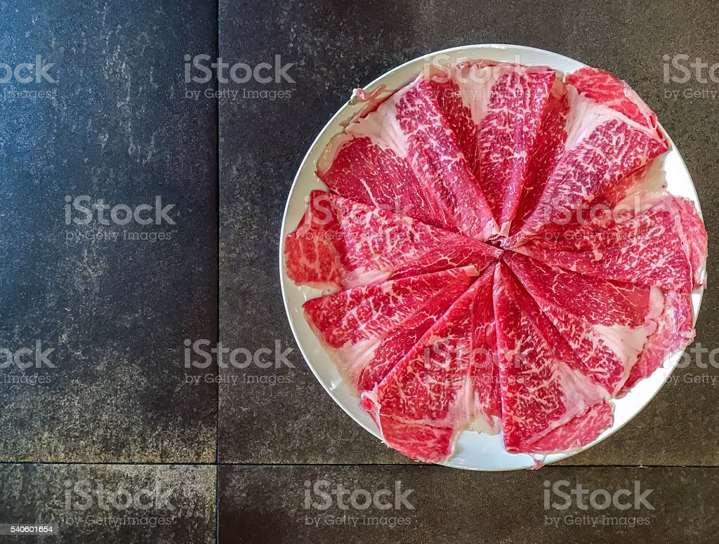 Plate of wagyu A5 marble beef with copy space stock photo