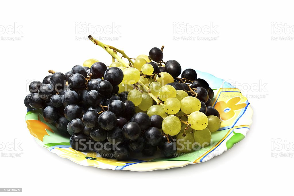 Plate of white and black grapes royalty-free stock photo