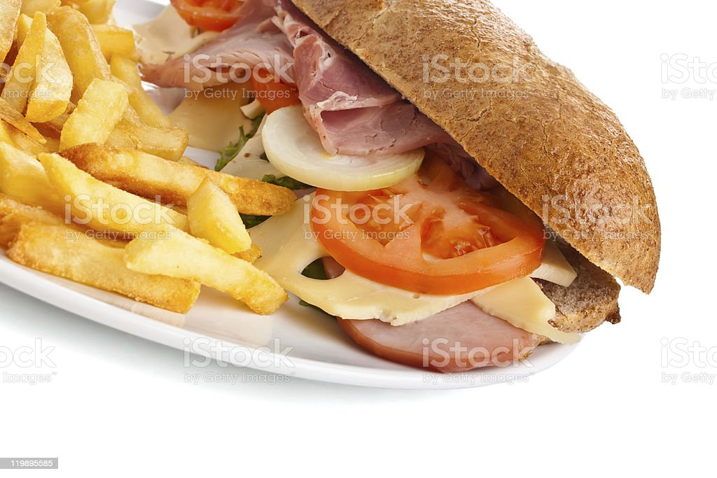 plate of whole wheat sandwich with fries royalty-free stock photo