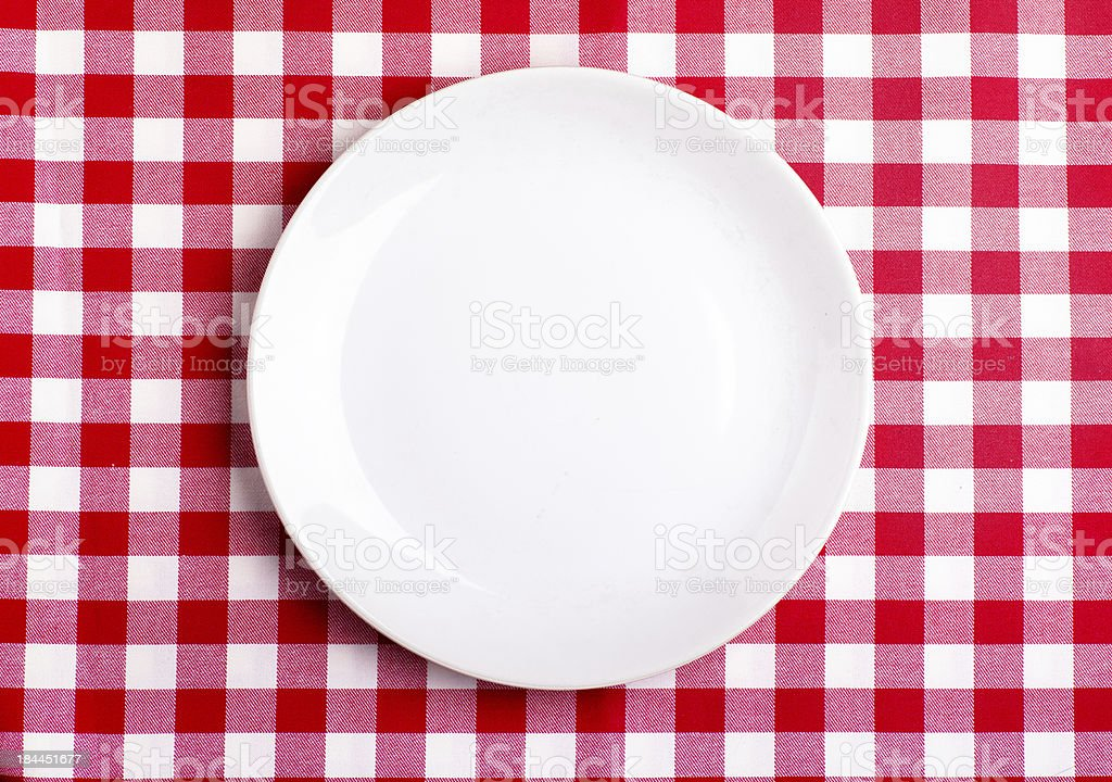 Plate on a tablecloth royalty-free stock photo