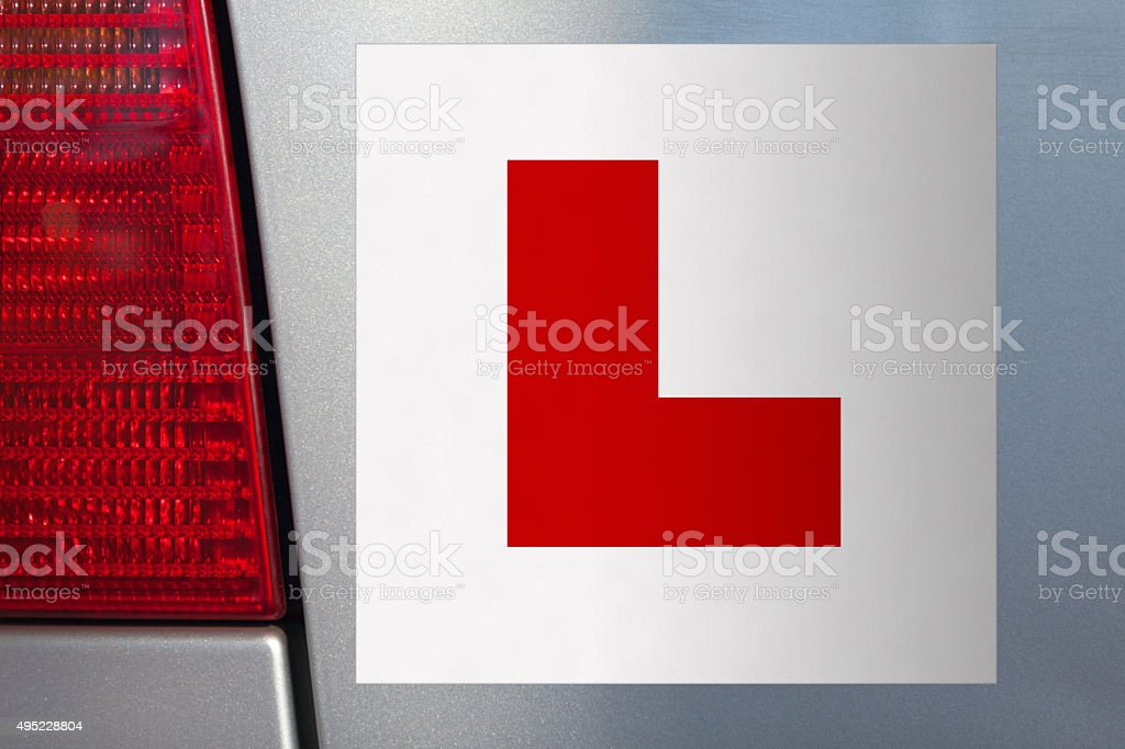L Plate on car for learner driver stock photo