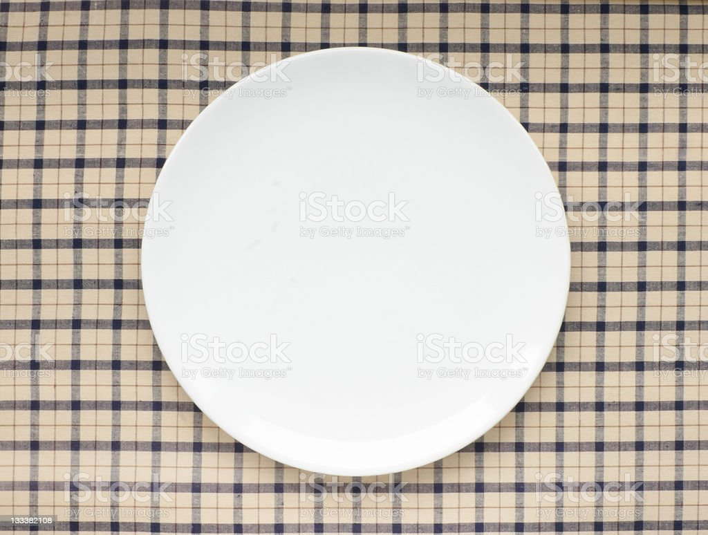 Plate on tablecloth stock photo