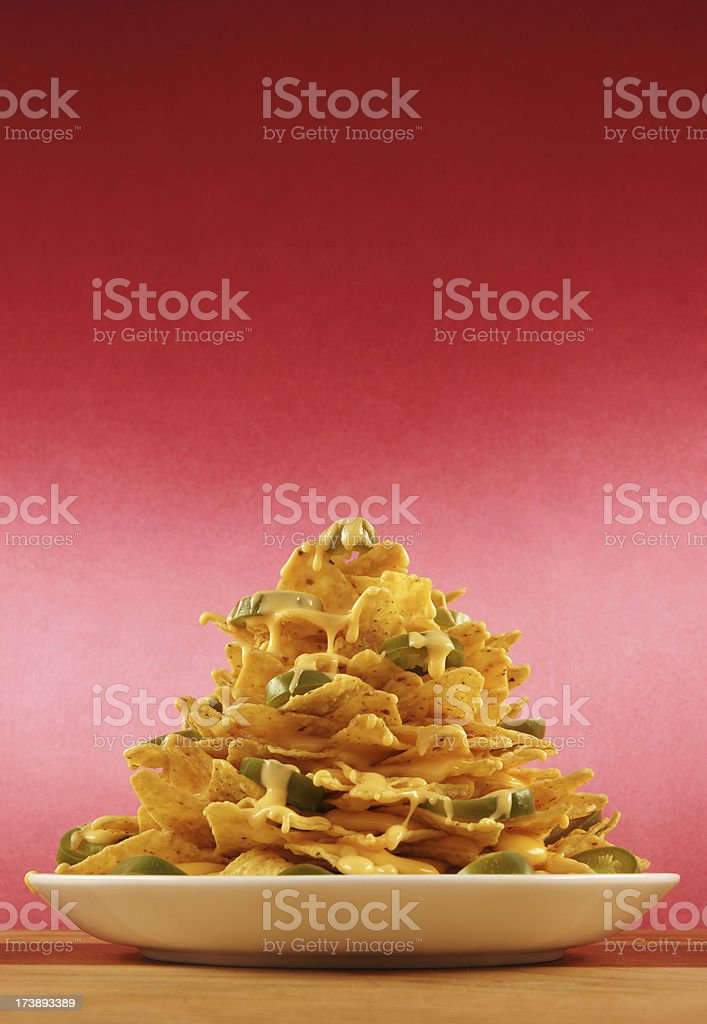 Plate piled very high with nachos stock photo