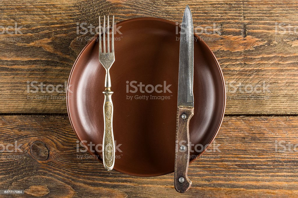 plate setting on wooden table stock photo