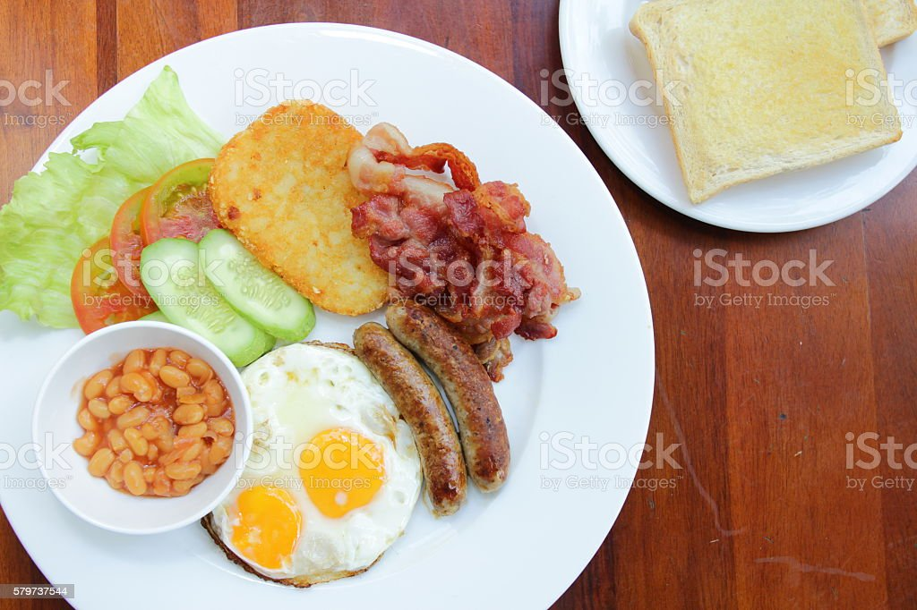 plate with boiled rice egg and sausage, fry shrimp, bacon stock photo