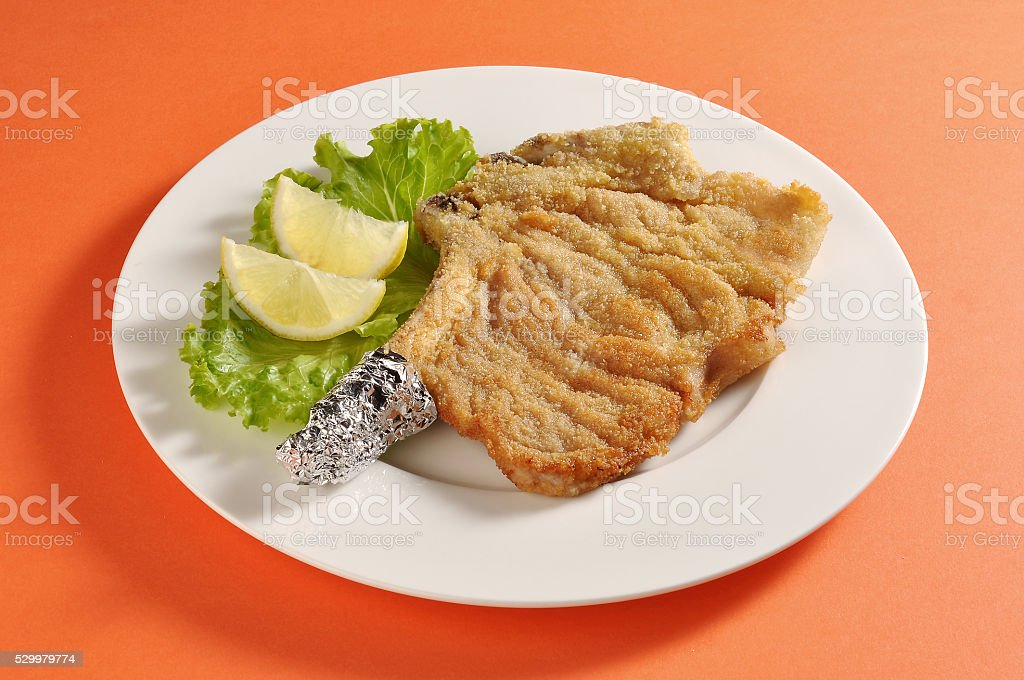 Plate with breaded cutlet Milanese stock photo