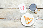 Plate with cake and cup of coffee