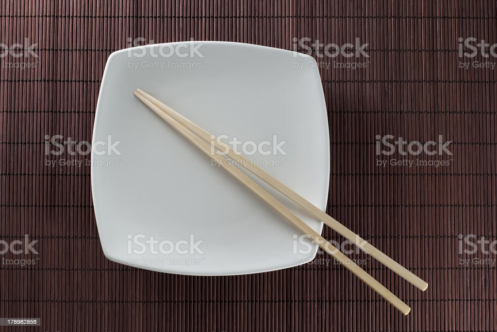 plate with chopsticks stock photo