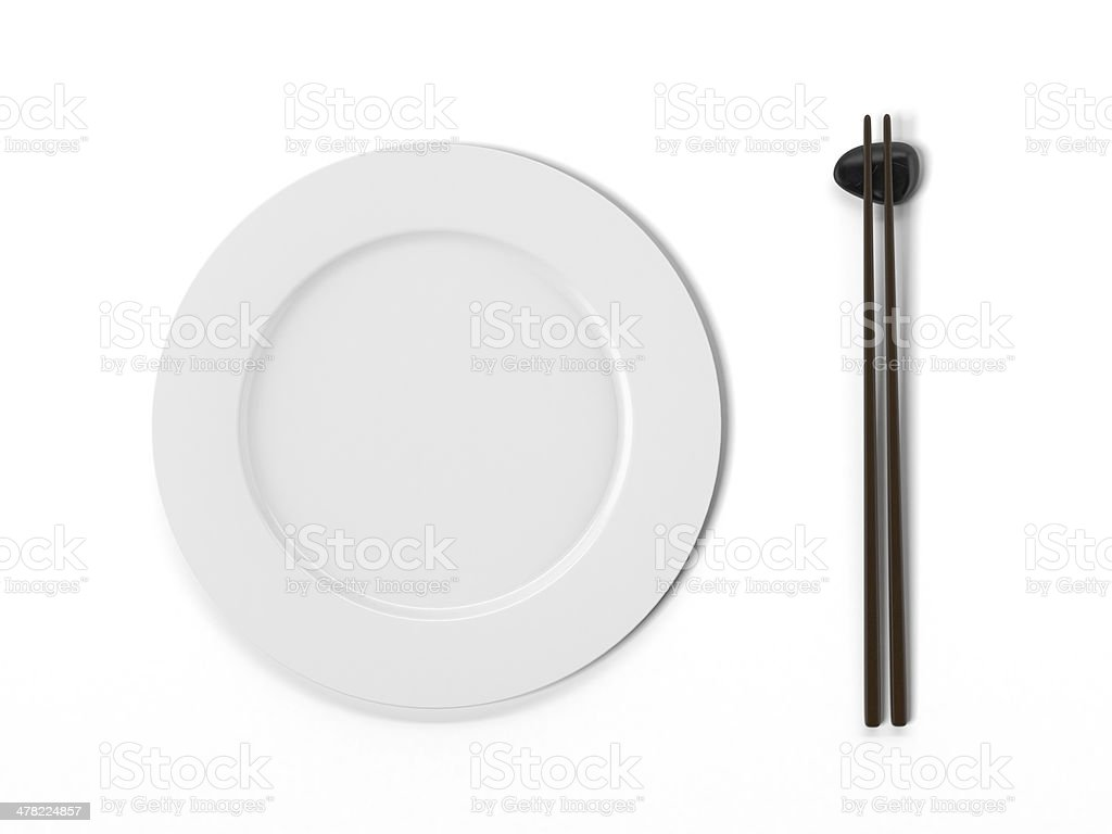 Plate with chopsticks royalty-free stock photo