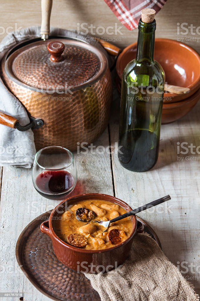 Plate with fabada asturiana, a typical spanish bean stew stock photo