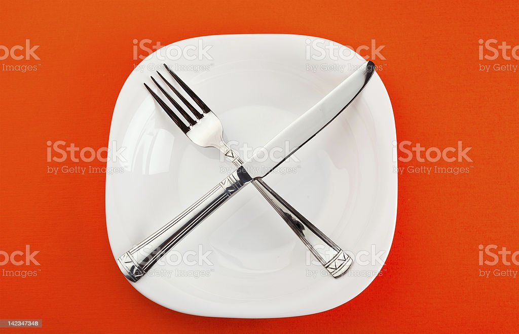 plate with fork and knife royalty-free stock photo