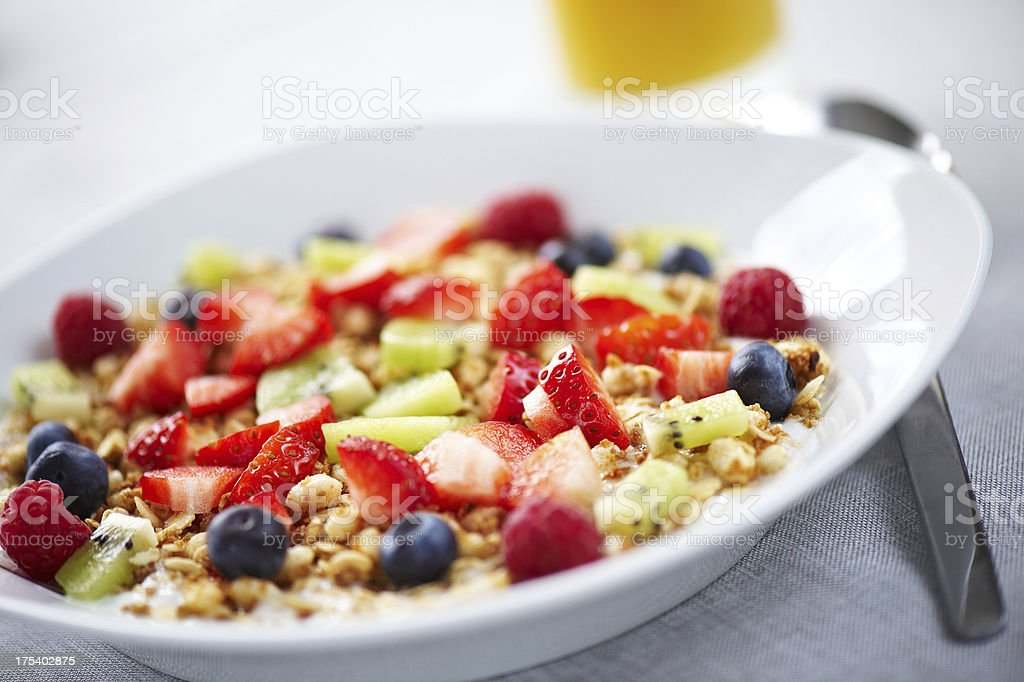 Plate with fresh fruit on yougurt and muesli royalty-free stock photo