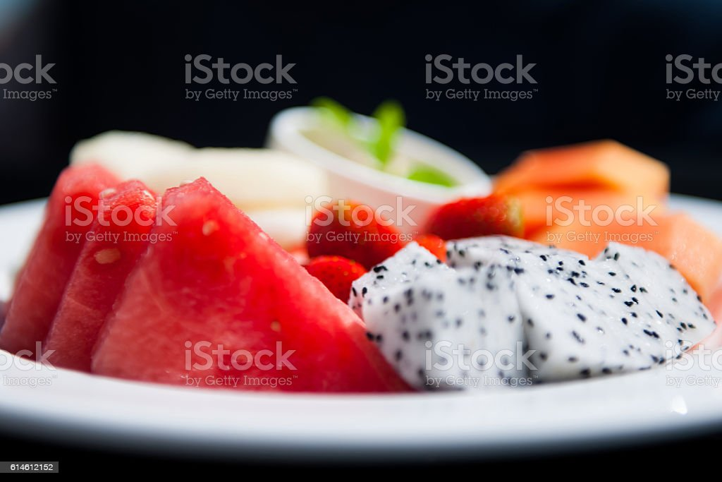 Plate with fresh fruits stock photo