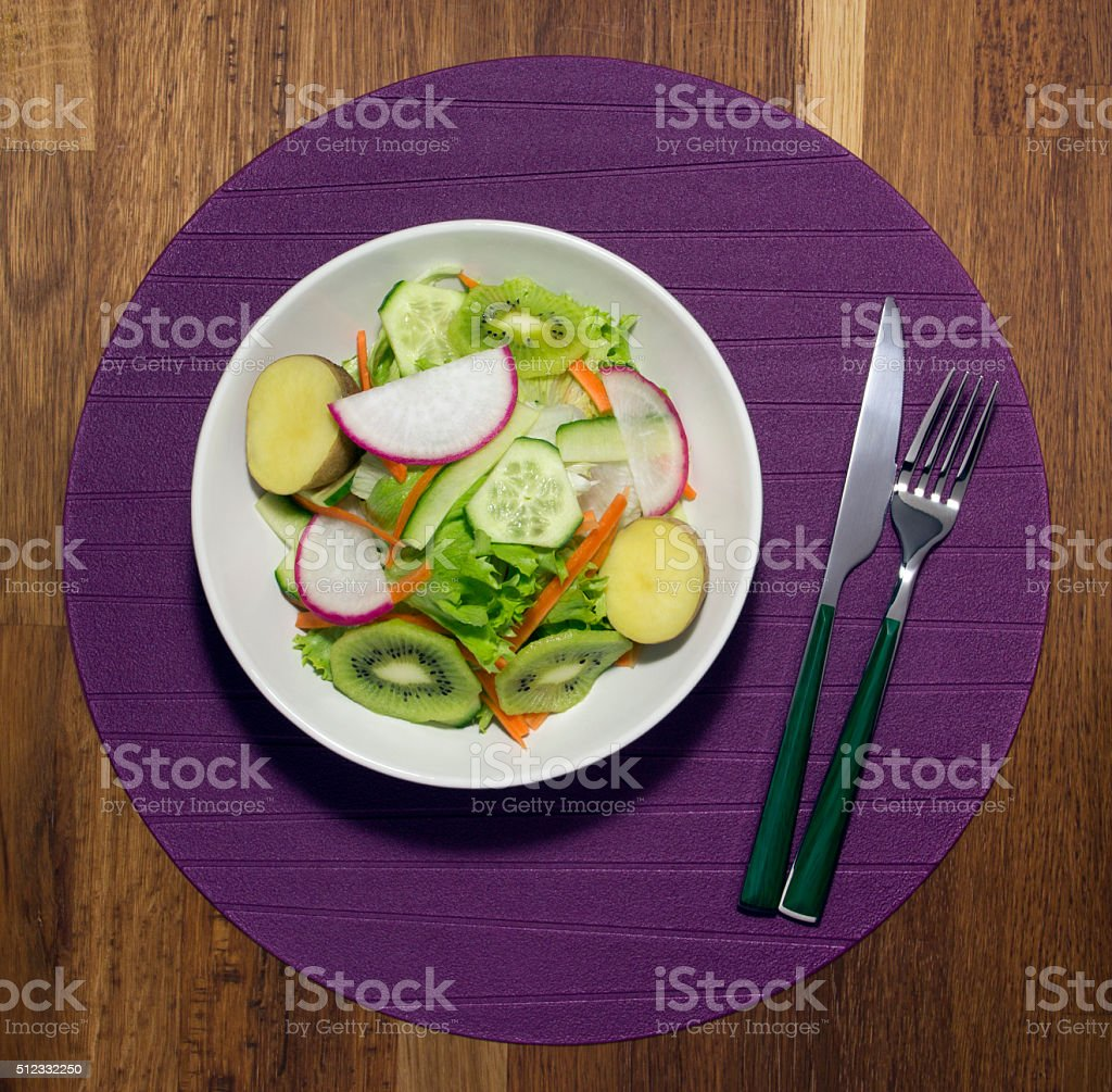 Plate with fresh salad, knife and fork. Diet food stock photo