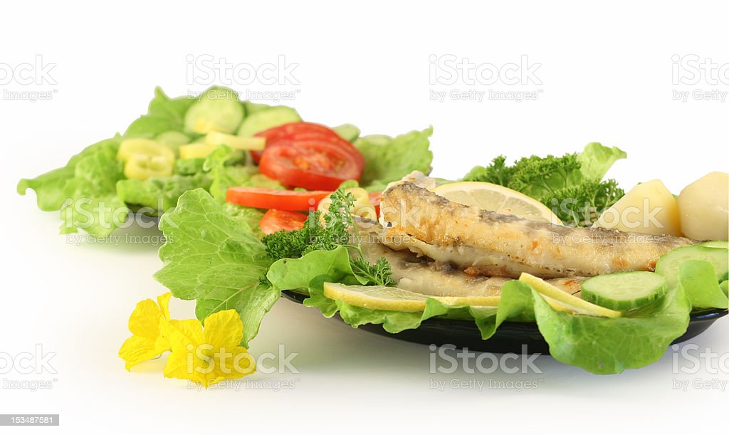 Plate with fried fish. royalty-free stock photo