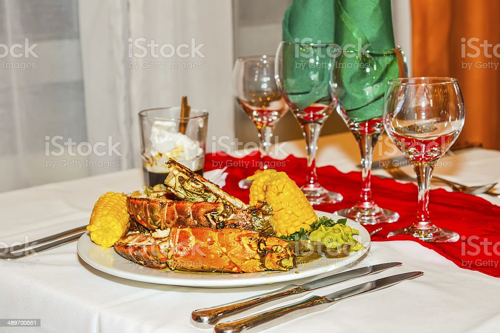plate with lobsters and vegetables, a dinner at restaurant stock photo